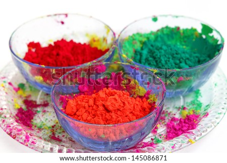 Vivid color gulal kept in a bowl focus on orange - stock photo