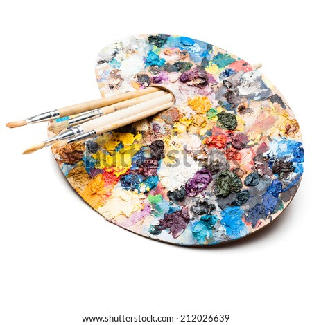 vivid colorful palette and brushes isolated on white - stock photo