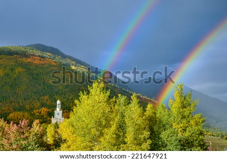 Vivid double rainbow over Silverton Colorado county courthouse in early autumn - stock photo