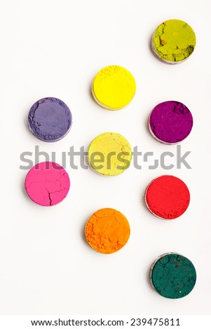 Vivid Indian Holi festival colours against a white background - stock photo