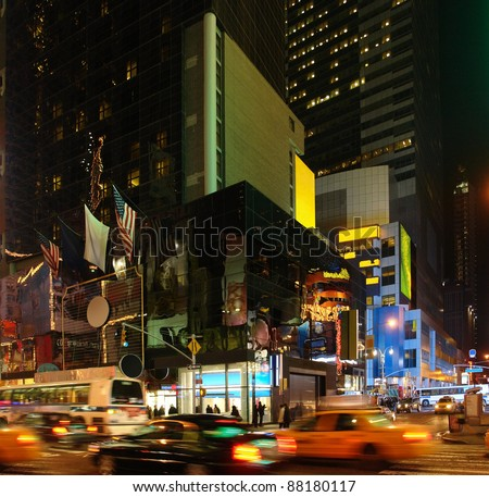 vivid night scenery showing the fantastic illuminated Times Square in New York (USA) with driving cars - stock photo