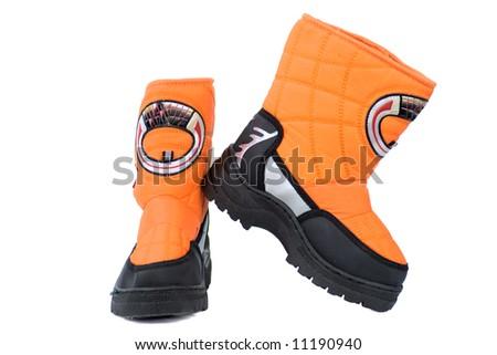 Vivid orange winter Sports boots isolated on white - stock photo