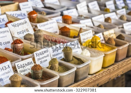 Vivid oriental central asian market with bags full of various spices in Osh bazar in Bishkek, Kyrgyzstan. - stock photo