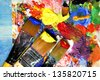 Vivid playful strokes and paintbrushes - stock photo