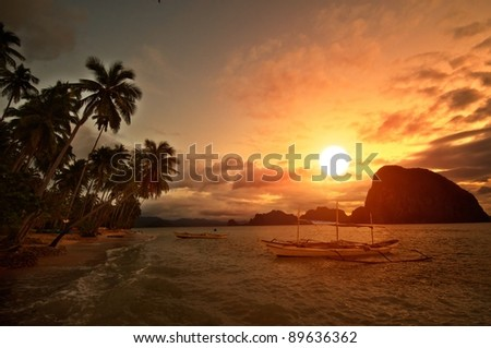Vivid Sunset in Getaway Tropical Destination - stock photo