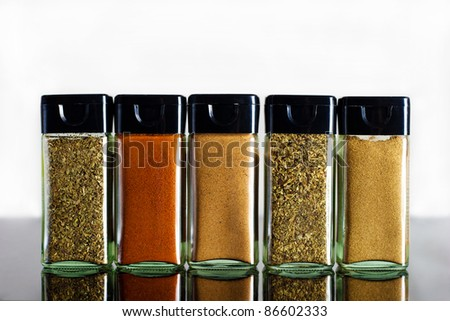 vivid variety of spices in glass jar - stock photo