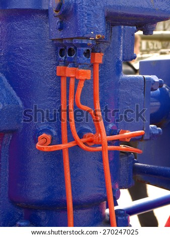 vividly, bright colored unusual vintage hydraulic equipment - stock photo