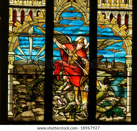 Vividly colored stained glass window from a Christian church - stock photo