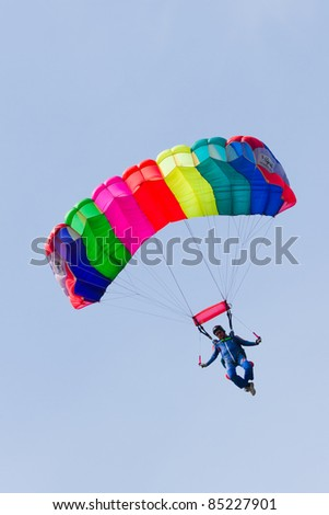 VLAARDINGEN, THE NETHERLANDS - MAY 5: Unidentified parachutist jumps from an airplane during the celebration of Liberation Day on May 5, 2011 in Vlaardingen, The Netherlands. - stock photo