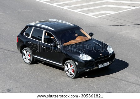 VLADIMIR, RUSSIA - AUGUST 24, 2011: Motor car Porsche 955 Cayenne at the city street. - stock photo