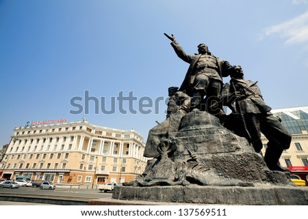 VLADIVOSTOK - APRIL 28 : socialistic monument on a main square , on april 28, 2013, Vladivostok. Russia. Vladivostok is the largest port on Russia's Pacific coast. - stock photo