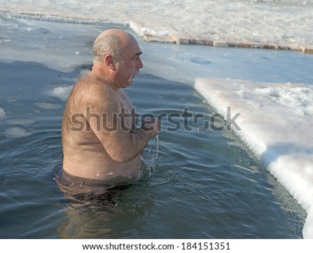 Vladivostok, Russia, Amur Bay January 20, 2014  Unidentified man, according to the Russian tradition, January Vladivostok residents basking in the hole on the ice