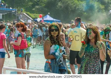 VLADIVOSTOK, RUSSIA - AUGUST 9, 2014: People celebrated Holi Festival of Colors, in Vladivostok. Holi, one of the biggest festivals in Asia.  - stock photo