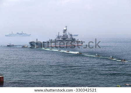 Vladivostok/Russia - 07 26 2014: Illustrative show for general public during Russian Navy Day showing marines landing and securing the coast with their military equipment