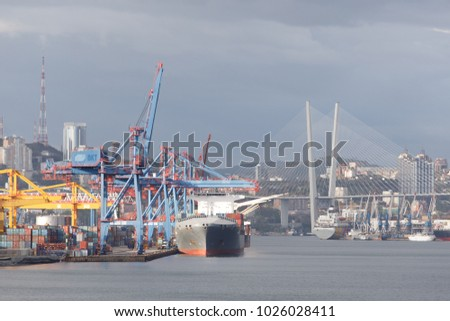 Vladivostok, Russia - May 15th, 2017: Port Vladivostok, territory of port with piers and the ships at them.