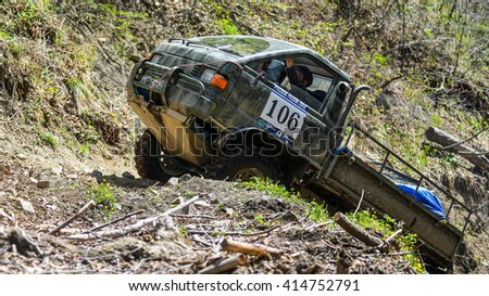 "Vladivostok, Russia - may 1, 2014: Toyota Lit-ace cars, motorcycles, Enduro and ATV, go off-roading in five-day race ""Russian rally 2014"""