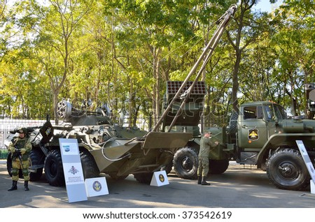 "Vladivostok, Russia, October, 11, 2015.  Armoured repair recovery vehicle BREM-K and fighting vehicle MLRS ""Tornado-G"""