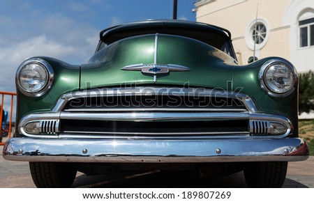 VLADIVOSTOK, RUSSIA - SEPTEMBER 7, 2013: Old american classic car is parked on Vladivostok's waterfront. - stock photo