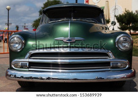 VLADIVOSTOK, RUSSIA - SEPTEMBER 7: Old American classic cars are on Vladivostok's waterfront on September 7, 2013 in Vladivostok, Russia.  - stock photo
