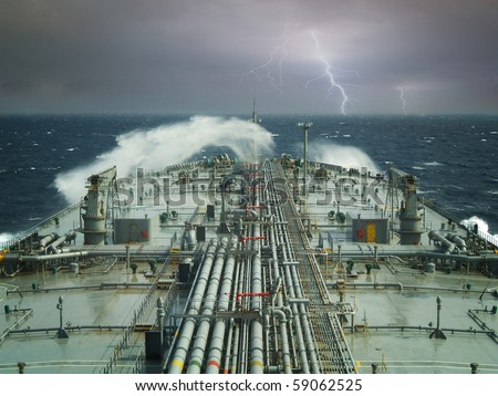 vlcc or oil tanker ship on open rough sea - stock photo