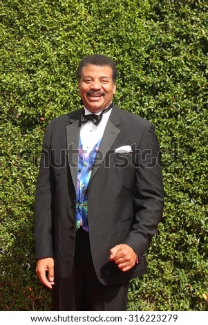 vLOS ANGELES - SEP 12:  Neil deGrasse Tyson at the Primetime Creative Emmy Awards Arrivals at the Microsoft Theater on September 12, 2015 in Los Angeles, CA - stock photo