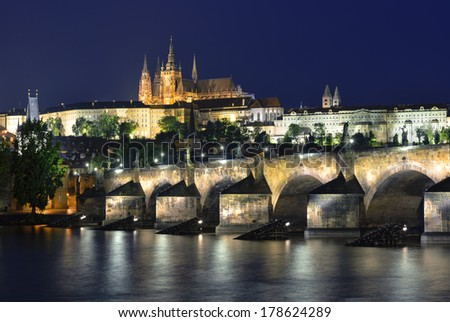 Vltava river, Charles Bridge and St. Vitus Cathedral at night against a dark blue sky. Karluv Most, Prazsky hrad. Staré M?sto, Prague. Czech Republic