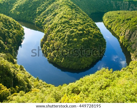 Vltava river horseshoe meander with green forest. View from Maj vantage point near Prague in central Bohemia, Czech republic
