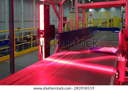 VNUKOVO, MOSCOW REGION, RUSSIA - APR 7, 2015: Russian Post. Logistics center in Vnukovo, automatic machine for bar code scanning correspondence with a moving conveyor belt - stock photo