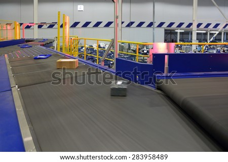 VNUKOVO, MOSCOW REGION, RUSSIA - APR 7, 2015: Russian Post. Logistics center in Vnukovo, parcels traveling on the conveyor belt