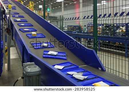 VNUKOVO, MOSCOW REGION, RUSSIA - APR 7, 2015: Russian Post. Logistics center in Vnukovo, parcels traveling on the conveyor belt - stock photo