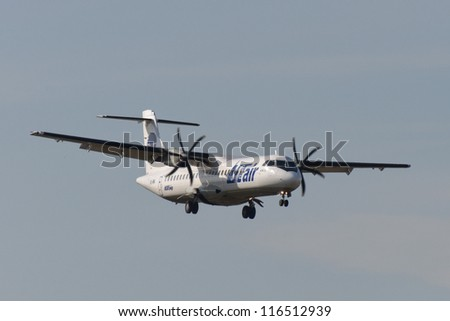 VNUKOVO, RUSSIA - SEPTEMBER 21: Aircraft operated by Utair, landing in Moscow airport in Vnukovo on September 21, 2012. The company Utair in its fleet has 22 aircraft ATR-72