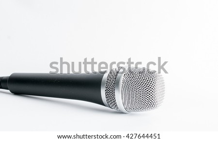 Vocalist, speaker or singer's microphone isolated on white.