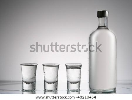 vodka and glasses still - stock photo