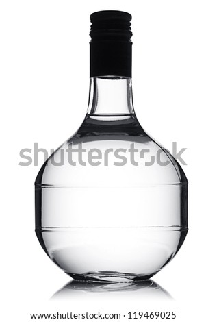 Vodka bottle in the shape of a round carafe. - stock photo