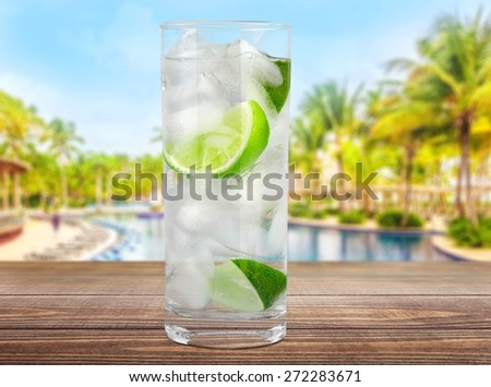 Vodka. Cocktail with ice and lime slice isolated on white background - stock photo