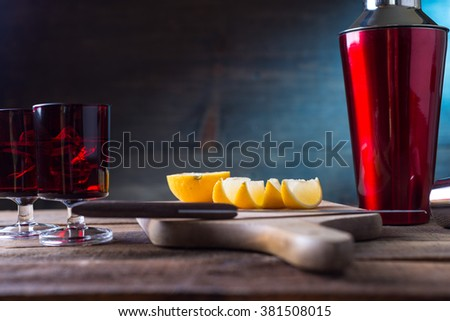 Vodka drinks with lemon and lime garnish - stock photo
