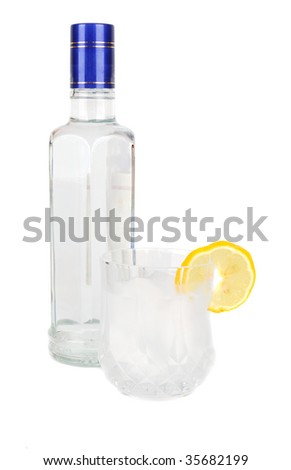 vodka glass bottle  and lemon  isolated on white background - stock photo