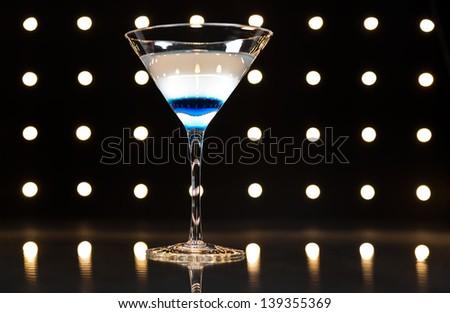 vodka martini on the disco dance floor - stock photo