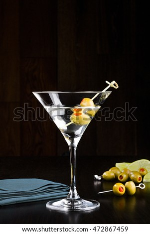 vodka martini with green stuffed olives
