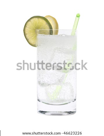 Vodka or Gin & Tonic mixed drink with lemon/line slice garnish on white background - stock photo