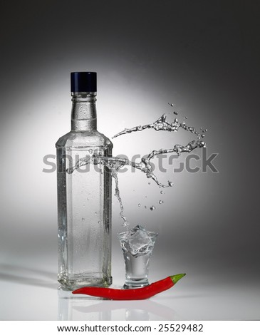 Vodka, red cayenne and unusual splash. - stock photo