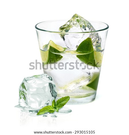 Vodka with ice and lime wedge isolated on white background - stock photo