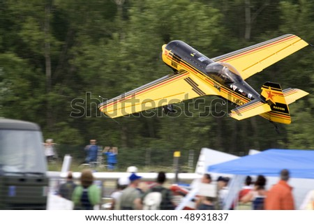 VOGHERA, ITALY - MAY 21: Aerobatic Lithuanian pilot engineer Jurgis Kairys flying by side at low altitude at  Voghera Air Show may 21, 2006 in Rivanazzano (Voghera), Italy. - stock photo