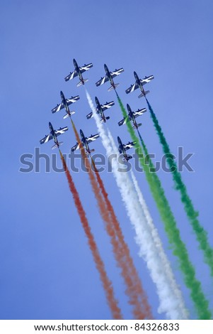 "VOGHERA, ITALY - MAY 21: Aerobatic team ""Frecce Tricolori "" of the Italian Air Force on aircraft Aermacchi MB-339-A/PAN in flight at  Voghera Air Show on May 21, 2006 in Rivanazzano (Voghera), Italy. - stock photo"