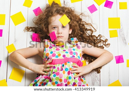 Vogue little girl in rainbow dress with stickers do-it. - stock photo