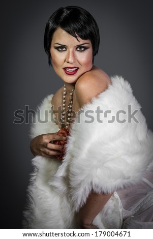 Vogue, Retro posing lady,  flapper dress, Girl dreaming beautiful young woman from roaring 20s looking at camera.  vintage twenties - stock photo