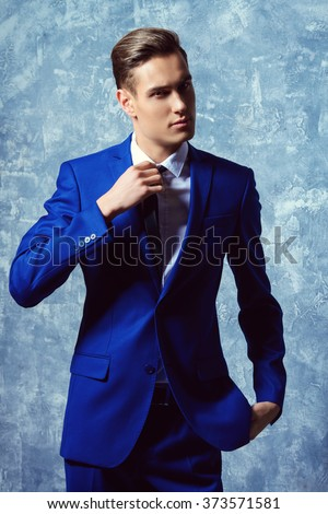 Vogue shot of a handsome young man in elegant classic suit. Men's beauty, fashion. - stock photo
