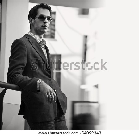 Vogue style black white photo of an handsome businessman