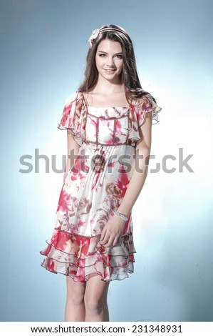 Vogue style fashion model on light background - stock photo