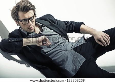Vogue style image of a young man - stock photo